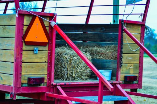 hay ride trailer with caution sign