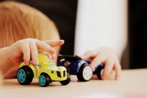 Toddlers playing with cars